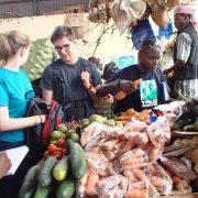 students at market
