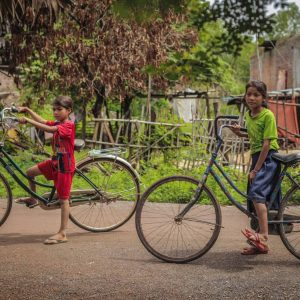 kids on bikes in Cambodia